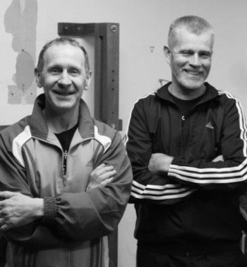 Ged Kennerk (Stockport Wing Chun Academy) standing next to his teacher David Peterson (Malaysian Combat Science WSL VT) in the picture